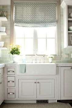 Farmhouse sink, white cabinets, white kitchen, open shelving, bridge faucet, handpainted seaglass colored tile