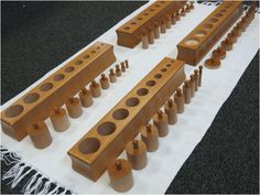 "To introduce the work: Invite the child to the Sensorial area and identify the material: ""These are the knobbed cylinders.""  There are four blocks. Block 1"