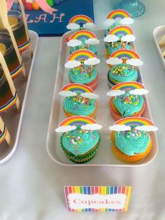 Rainbow birthday party cupcakes! See more party planning ideas at CatchMyParty.com!