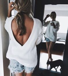 open back sweater and cutoffs