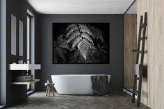 Dark bathroom with a large statement piece of art in black and white