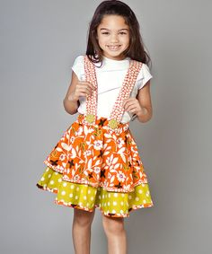 As bright and bold as a butterfly, this cotton skirt and suspenders set is full of color and cheer. Layered over the charming tee, they're ever ready for a fun flight of fancy.Includes tee, skirt and suspenders100% cottonMachine wash; tumble dryImported