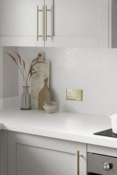 Need white laminate countertop ideas? Our White Sparkle Quartz Effect Laminate Worktop is a great addition to any modern kitchen design. Finish with matching sparkle quartz effect backboard, dove grey kitchen cabinets and brass kitchen hardware. Kitchen Worktops, Brass Kitchen, Grey Kitchen Cabinets, Kitchen Hardware, White Laminate, Laminate Countertops, Dove Grey, Work Tops, Modern Kitchen Design