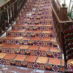 tileometry: Spied this lovely #TileTuesday gorgeousness of #Saltillo #tile colorful #handpainted #Mexican #Talavera #tiles on Rustico Tile & Stone's website. Such a dramatic #staircase with handmade #wood #railings! // #architecture #ceramic #design #decor #exteriors #exteriordesign #hospitality #hardscape #lasvegas #restaurant #tiledesign #tilework #tileometry #tileinspiration #tilelove #tilestyle