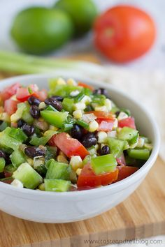 Black Bean, Corn and Tomato Salad - A fresh salad filled with beans, corn, tomatoes and bell pepper that gets better the longer it sits.