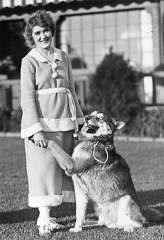Mary Pickford and her dog at Pickfair.                                                                                                                                                                                 More
