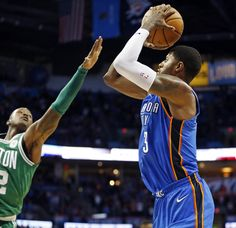 Oklahoma City's Paul George (13) shoots as Boston's Terry Rozier (12) defends during an NBA basketball game between the Oklahoma City Thunder and the Boston Celtics at Chesapeake Energy Arena in Oklahoma City, Friday, Nov. 3, 2017. Boston won 101-94. Photo by Nate Billings, The Oklahoman