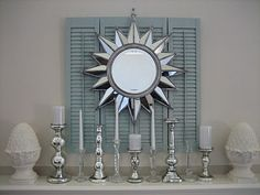 Dishfunctional Designs: Upcycled: New Ways With Old Window Shutters. Just took off the last set of shutters from out windows.need a DIY idea like this Old Window Shutters, Diy Shutters, Repurposed Shutters, Blue Shutters, Window Frames, Sunburst Mirror, Diy Mirror, Wall Mirror, Diy Mantel