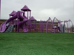 Under a playground! Synthetic Grass would work perfect! http://www.stdepot.com