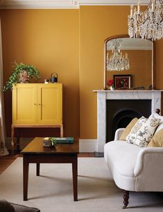 """Heckfield Place: the Ochre Room. """"We have not tried to be too bold with the color palette, choosing more muted colors that can be seen in nature,"""" Thompson explains. The drinks cabinet is by Benchmark. Room Color Schemes, Room Colors, Paint Colors, Ochre Bedroom, Mustard Living Rooms, Mustard Walls, Mustard Yellow, Mulberry Home, Country House Hotels"""