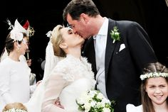 misshonoriaglossop:  Religous wedding of Hereditary Prince Alexander of Isenburg and Dr. Sarah Lorenz, Frauenwört-Church, island of Frauenchiemsee, Germany, July 12, 2014-a kiss between bride and groom