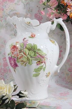 Rose pitcher: wouldn't be too hard to set up a photo booth with a wallpaper lining. Note the curve at the base of the wall--this is a set-up, not a real wall.