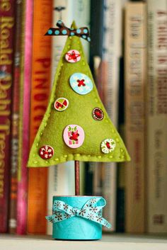 "Felt tree.  These would be cute in a group of three different heights and shades of green.  Would be a great ""learning to sew"" project for kiddos."
