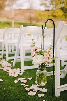 Ball Jar's with Wildflowers, are simple and elegant and give a great feel to an outdoor/barn wedding