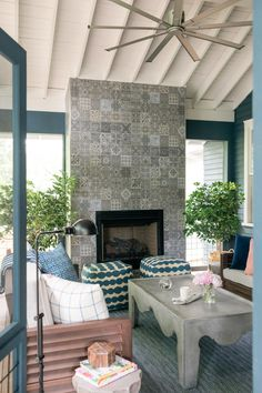 The generously sized screened porch with a focal point fireplace and comfortable seating offers a relaxed and stylish space for casual get-togethers at HGTV Urban Oasis 2017.