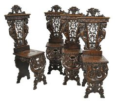 A set of four Italian elaborately carved scabellos