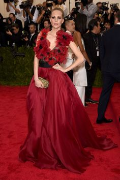 Poppy Delevingne Evening Dress - Poppy Delevingne was all abloom at the Met Gala in a red and black Marchesa gown with a flower-appliqued bodice.