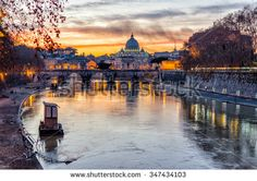 Scenic sunset over the Vatican City and Tevere River in Rome, Italy