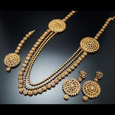 A stunning rani haar set made up with gold (LCT) Diamantes finished off with 2 strands of gold beads with beautiful matching earrings and tikka all set on fine gold plating. For more details visit our website Mens Gold Jewelry, Gold Jewellery Design, Wedding Jewelry, Handmade Jewellery, Walmart Jewelry, Indian Jewelry, Jewelry Sets, Swarovski, Fashion Jewelry