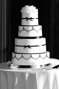 black and white. classic and clean. chandlier piping and tiny little bows make this cake timeless and elegant
