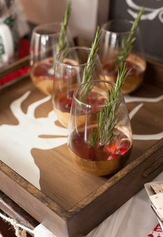 Dress up Christmas cocktails! Use whole cranberries to garnish and sprigs of rosemary as stirrers--a little pop of green and red make drinks instantly more festive.