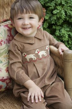 Classic Little English smocked romper with hand smocked labs on our camel corduroy.