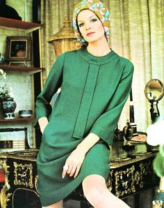 Willy van Rooy is wearing a green crêpe dress by Susan Small, Vogue UK September 1967