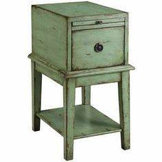 """Bring rustic appeal into your home with this green end table, featuring 1 drawer and 1 pull out tray in a distressed finish. Product: End tableConstruction Material: WoodColor: GreenFeatures: One drawerOne pull-out trayOpen lower shelfDimensions: 26.25"""" H x 14"""" W x 19"""" D"""