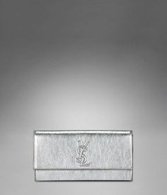 Check out Medium YSL Clutch in Metallic Silver Leather at http://www.ysl.com/en_US/product/803495736