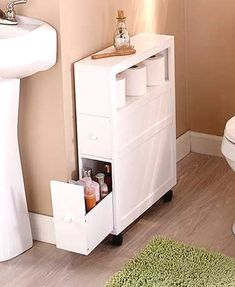 "Add storage to your bathroom without taking up too much space with this slim organizer. This rolling organizer has 2 drawers and an open shelf for toilet paper, toiletries and more. A hidden holder in the back can be used for a toilet brush or small plunger. With 4 wheels (2 of which lock), you can move it around wherever you need it. 6-1/4""W x 20-1/2""D x 27-3/4""H. MDF. Assembly required; assembly hardware included. Maximize space with a rolling storage unit Has an open shelf, 2 drawer.."