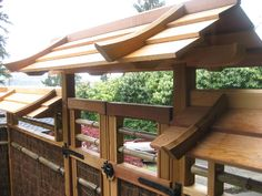 Detail of the gate. The roof design sheds the rain off, protecting the main part of the fence materials.