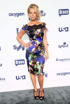7+ Dina Manzo looks, including Gold Dangle Earrings, Print Dress, Bangle Bracelet, Beaded Bracelet, Layered Gold Necklace and more.