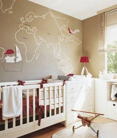 World traveler painted wall...LOVE THIS!!  @Christine Cohn, this would be a fun and easy DIY for Jonathan's room and would look super cool on a navy wall.  Love the little pirate in a boat, too.  :)