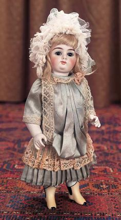 German All-Bisque Doll with Yellow Boots by Gebruder KuhnlenzMarks: 96-14 (head and torso). Comments: Gebruder Kuhnlenz,circa 1900.