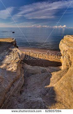Eroded limestone cliffs by the coast of Estonia in the Baltic Sea. The Gulf of Finland. Shutterstock contributor.