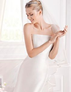Ermelinda   San Patrick  Brunswick Emporium  This classic fit and flare wedding gown is a perfect choice for the minimalist bride. Princess panels draw the eye in and make this a flattering design. Finish the look with a lace jacket that sits off the shoulders.