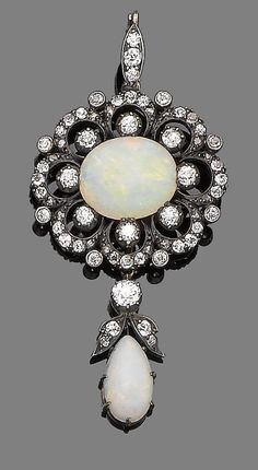 An opal and diamond pendant necklace, circa 1890. Designed as a flowerhead, centrally-set with an oval cabochon opal, within an openwork surround of rose and old brilliant-cut diamonds, suspending a detachable pear-shaped cabochon opal surmounted by similarly-cut diamonds of foliate detail, to a later trace-link chain, mounted in silver and gold, old brilliant-cut diamonds approx. 1.15ct total, lengths: pendant 6.0cm, chain 35.0cm
