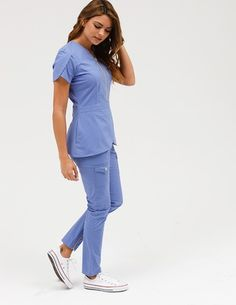 The Tulip Top in Ceil Blue is a contemporary addition to women's medical scrub outfits. Shop Jaanuu for scrubs, lab coats and other medical apparel. Scrubs Outfit, Scrubs Uniform, Medical Uniforms, Work Uniforms, Nursing Uniforms, Stylish Scrubs, Cute Scrubs, Medical Scrubs, Nursing Scrubs