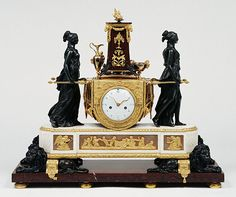 "Mantel Clock, French, Paris, about 1789.""An ancient Roman religious rite inspired this clock, designed in the Neoclassical style after a drawing by Hubert Robert that was published as an engraving between 1771 and 1773. Two bronze priestesses of the temple of Vesta, the ancient Roman goddess of the hearth and its fire, carry the altar bearing the sacred flame."""