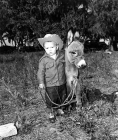 Young boy with month old Sicilian donkey. November The grandson of George Garretson, owner of Palomino stables in Ocala, with month old Sicilian donkey. Courtesy: State Archives of Florida, Tallahassee, FL (USA) Baby Donkey, Cute Donkey, Mini Donkey, Animals For Kids, Animals And Pets, Baby Animals, Cute Animals, Animal Pictures, Cute Pictures