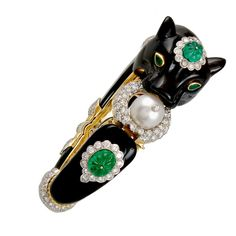 1stdibs - VAN+CLEEF+&+ARPELS+Diamond,+Onyx+and+Emerald+Panther+Bangle explore items from 1,700+ global dealers at 1stdibs.com