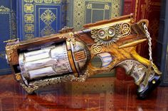 Steampunk Gun: Modified Nerf Maverick by Friston. Handpainted woodgrain with vintage brass elements.
