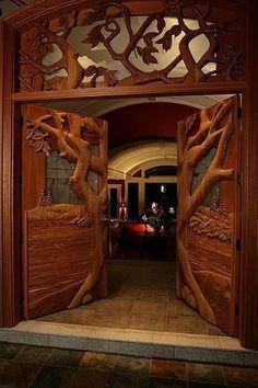 Now THAT's a door! Ornate carved tree door