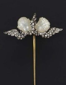 AN ANTIQUE MOONSTONE AND DIAMOND STICK PIN. Designed as two carved moonstone cherub heads, each with rose-cut diamond wings, mounted in silver and gold, circa 1900. #antique #StickPin