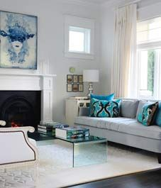 "White with some blue accents - we love the glass coffee table in a very light ""glass blue"" shade"
