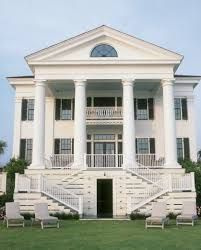 Greek Revival/  Federal exterior.  porticos supported by huge columns, pediments.