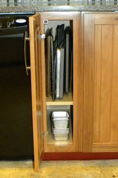 I love having a narrow cabinet for cookie sheets and cutting boards. And there's room at the bottom for loaf pans.