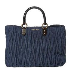 @Overstock - This denim ruched tote by Miu Miu features double, tortoise handles, and gold toned Miu Miu hardware. This tote is complete with a button snap closure and blue leather lining.http://www.overstock.com/Clothing-Shoes/Miu-Miu-Denim-Ruched-Tote/6836389/product.html?CID=214117 $949.99