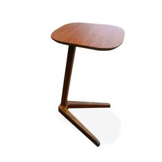 - Solid bamboo occasional table - Cantilever design to sit comfortably over your sofa or armchair - V shaped leg base with rubber underside for added stability - Caramelised Exotic stained finish (as pictured)