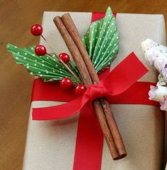 Gifts Dressed Up for the Holidays: Creative #Christmas #Wrapping Ideas brown paper, ribbon, cinnamon sticks, paper leaves and holly berries so pretty